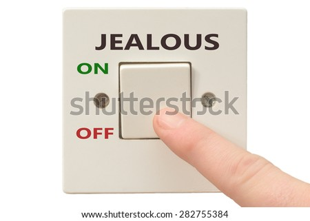 Turning off Jealous with finger on electrical switch - stock photo