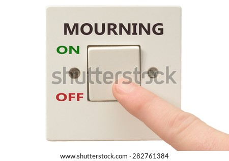 Turning off Mourning with finger on electrical switch - stock photo