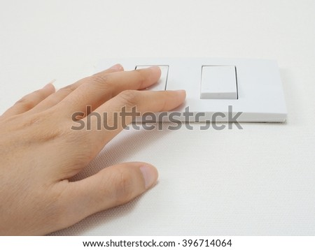 Turning off or Turning on the light switch - stock photo