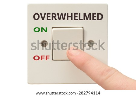 Turning off Overwhelmed with finger on electrical switch - stock photo
