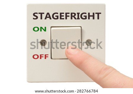 Turning off Stagefright with finger on electrical switch - stock photo