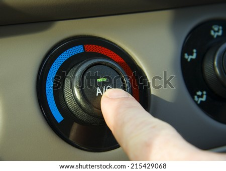 Turning on the AC in a hot car - stock photo