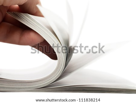 Turning over pages of thick magazine