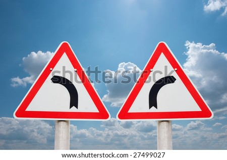 Turning road traffic signs showing opposite directions