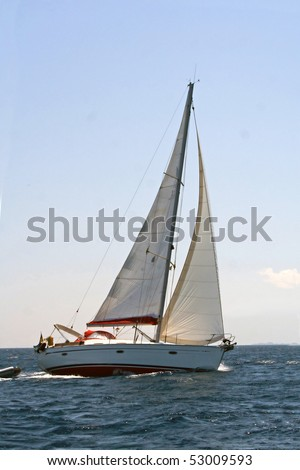 Turning sailing boat on the sea - stock photo