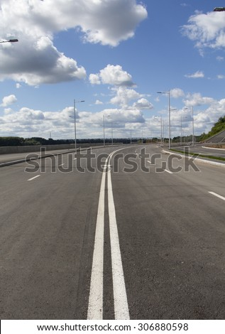 Turning street in big city. Blue sky and white cloud. - stock photo