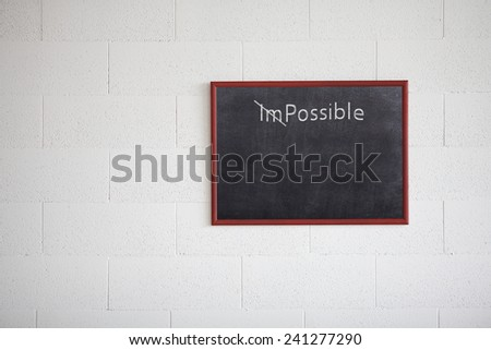 Turning the word Impossible into Possible, writing on chalkboard - stock photo