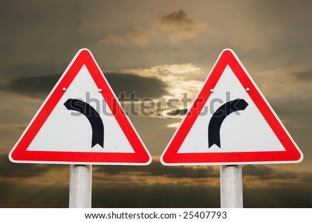 Turning traffic signs showing opposite directions