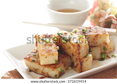 Turnip cake and xo sauce stir fried with tea - stock photo