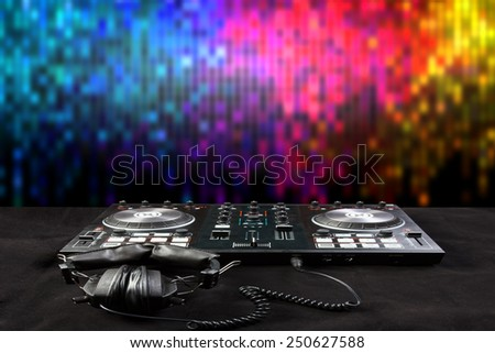 turntable and headphone for disc jockey to play music in nightclub at party  - stock photo