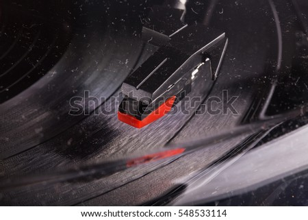 Turntable head seen through a dusty glass, horizontal image
