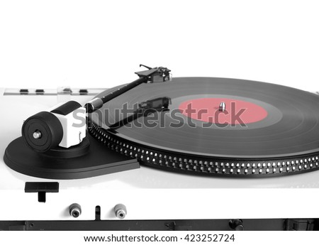 Turntable in silver case with rotation vinyl record with red label isolated on white background. Horizontal black and white photo rear view closeup - stock photo