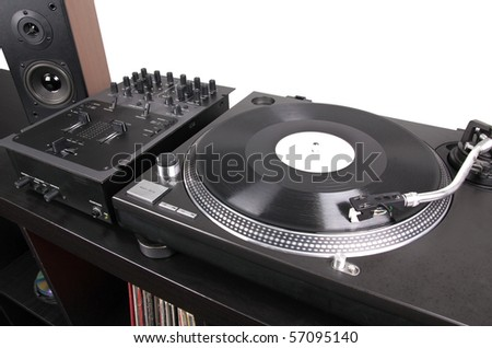 Turntable, mixer and loudspeaker on black table, closed-up - stock photo