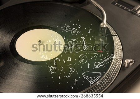 Turntable playing classical music with icon drawn instruments concept on background - stock photo
