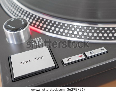 Turntable playing vinyl close up