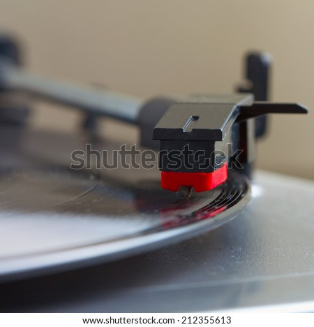 Turntable with a vinyl record, square image