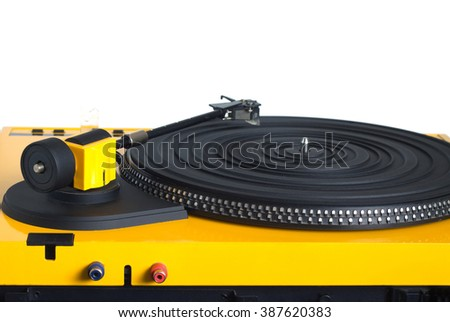 Turntable with black tonearm in yellow case with rubber mat on disc with stroboscope marks with output connectors rear view isolated on white background. Horizontal front view closeup