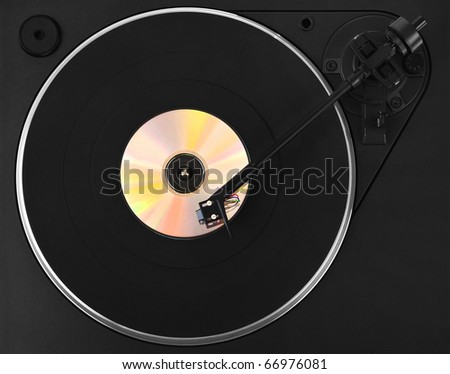 Turntable with colorful CD - stock photo