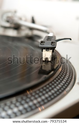 turntable with the needle on the vinyl disk - stock photo
