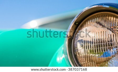 Turquise painted old vintage veteran car front lamp lighting close up details - stock photo