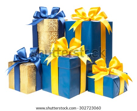 Turquoise and gold box with a gift and a yellow bow isolated on white background. - stock photo
