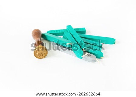 turquoise and silver sealing wax candles with stamp isolated on white background with shadow  - stock photo