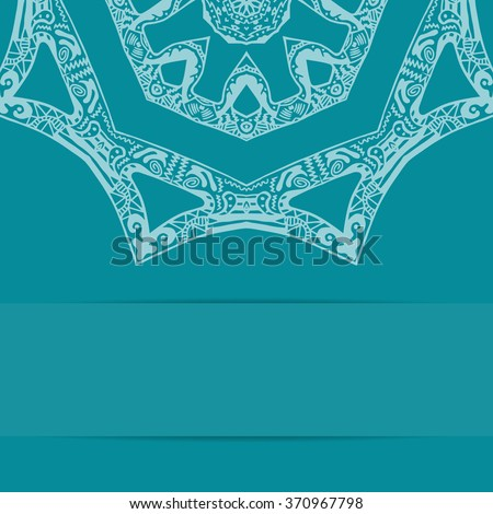 Turquoise blue card with decorative ornate pattern and copy space. Zentangle handdrawn style - stock photo