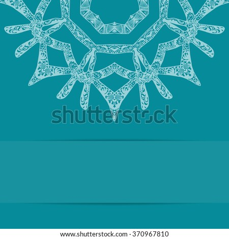 Turquoise blue card with ornate pattern and copy space. Zentangle and handdrawn style - stock photo