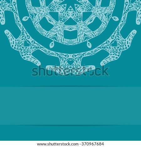 Turquoise blue card with zentangle style pattern and copy space - stock photo