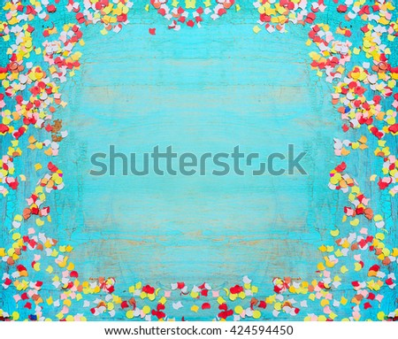Turquoise blue party background with confetti. Frame of confetti on shabby chic wooden background. Festive greening card. Invitation background - stock photo