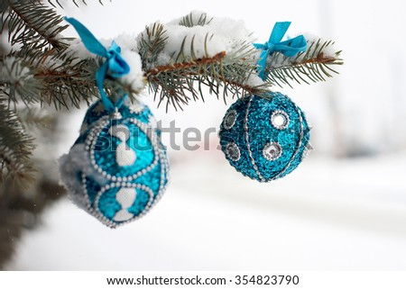 Turquoise Christmas ball on branch tree