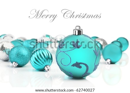 Turquoise  christmas decorations on a white background with space for text