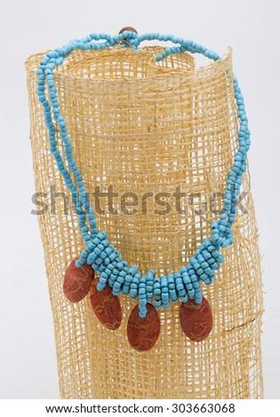 Turquoise classic necklace on white background - stock photo