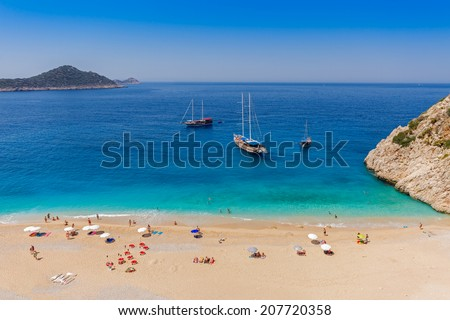 Turquoise Coast with Tourists and Yachts   - stock photo