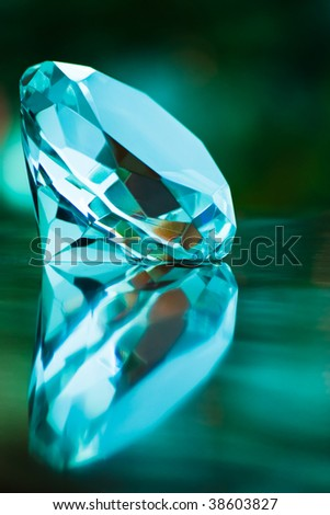 turquoise diamond in  with shallow depth of field - stock photo