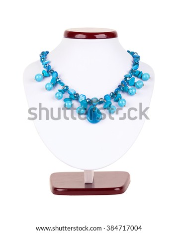 Turquoise fashion jewelry natural stones necklace on mannequin isolated on white background - stock photo