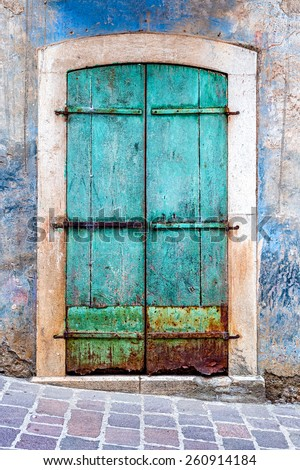 Turquoise grunge door. The photo taken in a small town in the middle of the Cilento and Vallo di Diano National Park (Campania, Italy). - stock photo