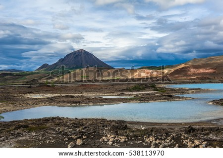 Turquoise hot pools and a mighty volcano at Namafjall, Myvatn area - Iceland