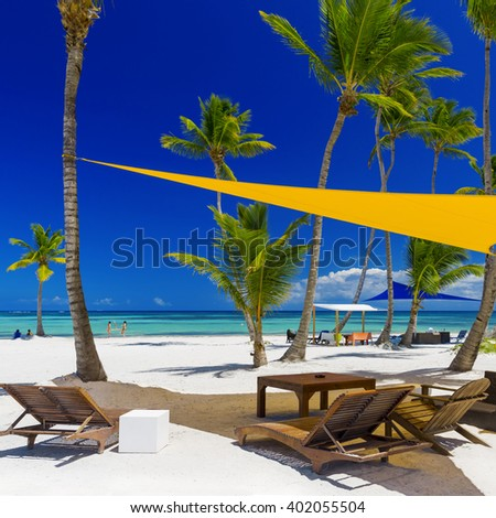 Turquoise lagoons of the tropical island. White sand of the coast. Beautiful place for restoration of forces, rest, aquatics, suntan and bathing. Warm sea water, palms, breeze. - stock photo