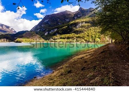 Turquoise lake in the mountains. Lake Tenno. Italy - stock photo