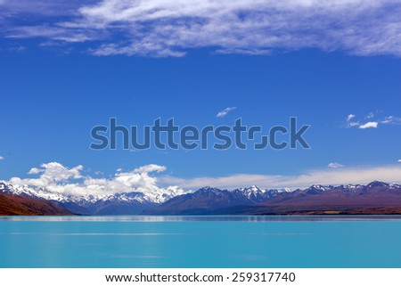 Turquoise Lake Tekapo and snow-capped Southern Alps, Canterbury, New Zealand - stock photo