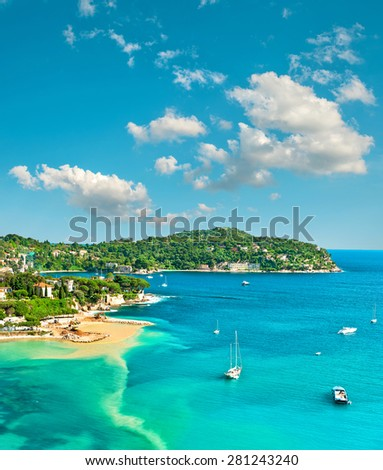 Turquoise Mediterranean sea and sloudy blue sky. Villefranche by Nice, French riviera. Summer holidays - stock photo