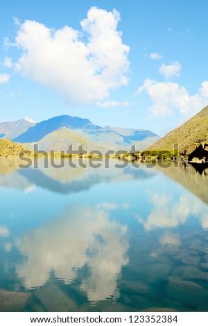 turquoise mountain lake under a cloudy sky, Altai, Siberia, Russia - stock photo