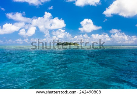 Turquoise ocean water and Idyllic tropical island of Sipadan in Sabah, Malaysia. - stock photo