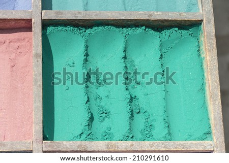 Turquoise pigment at a vendor - stock photo