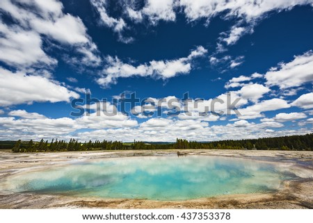Turquoise Pool, a hot spring, with reflection in the Midway Geyser Basin of Yellowstone National Park, Wyoming - stock photo