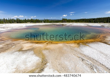 Turquoise Pool, a hot spring, with reflection in the Midway Geyser Basin of Yellowstone National Park, Wyoming