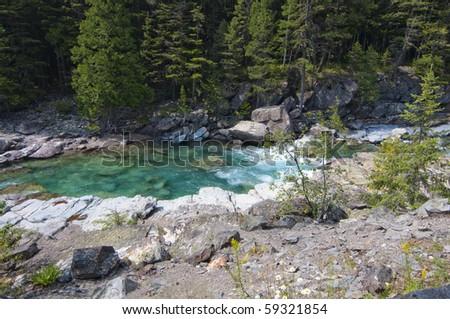 Turquoise river flowing towards Lake McDonald at Glacier National Park - stock photo
