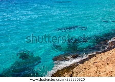 Turquoise sea ocean water near rocky coast. Beautiful mediterranean sea - stock photo