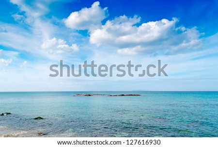 turquoise sea under a dramatic sky - stock photo